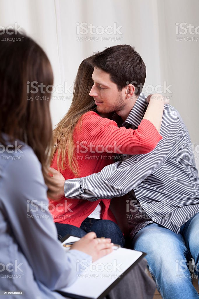 Happy couple during therapy stock photo