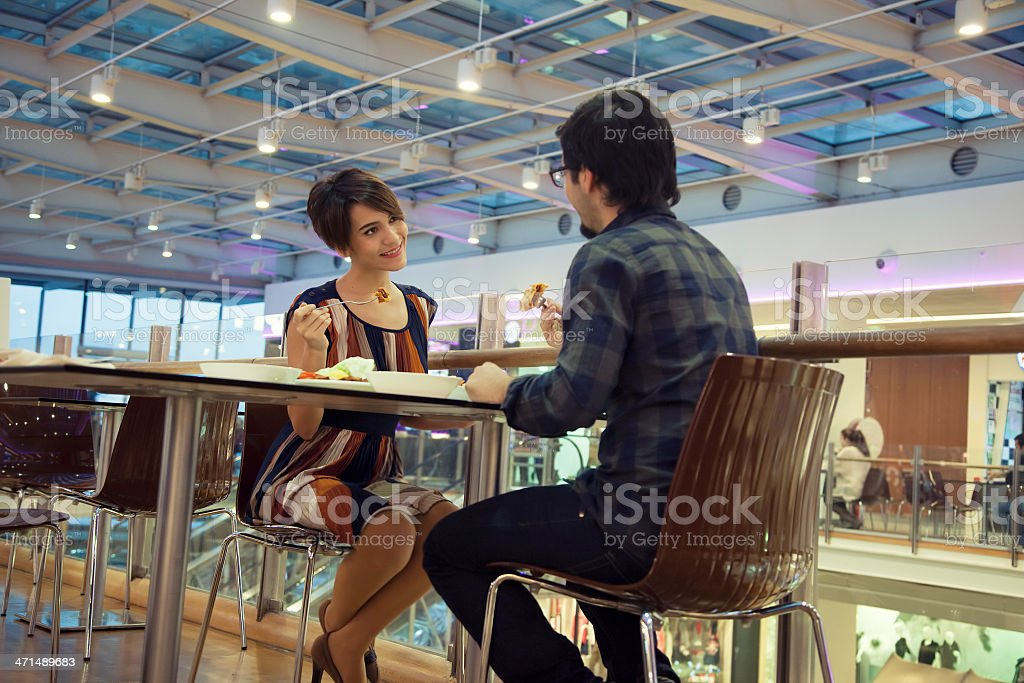 Happy couple eating at the mall royalty-free stock photo