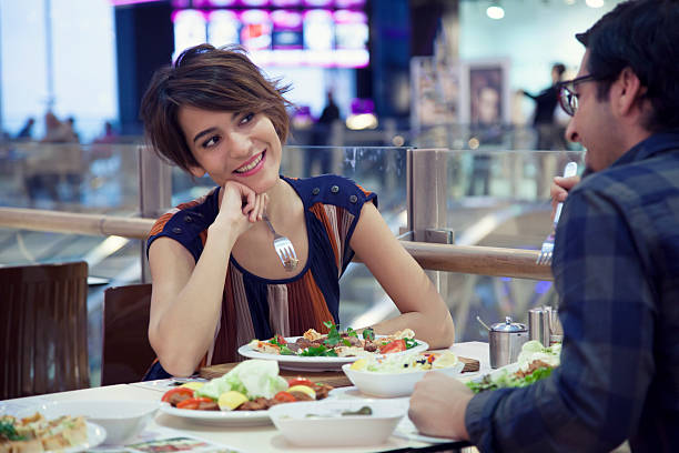 Happy Couple Eating At The Mall Stock Photo