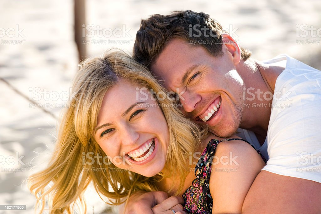Happy couple embracing and laughing royalty-free stock photo