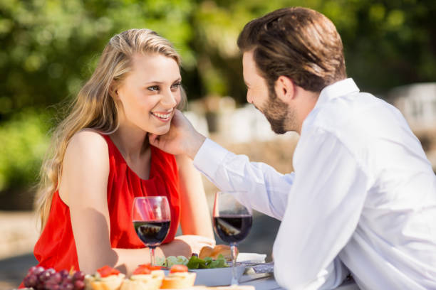 Happy couple embracing each other Happy couple embracing each other in the restaurant age contrast stock pictures, royalty-free photos & images