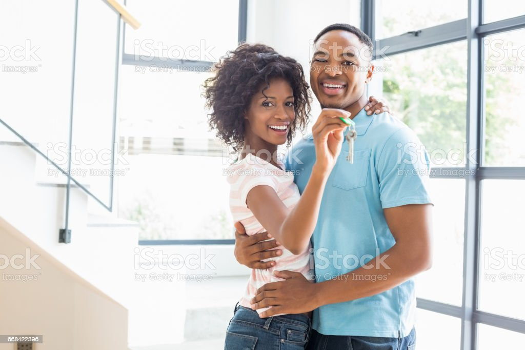 Happy couple embracing in their new home stock photo