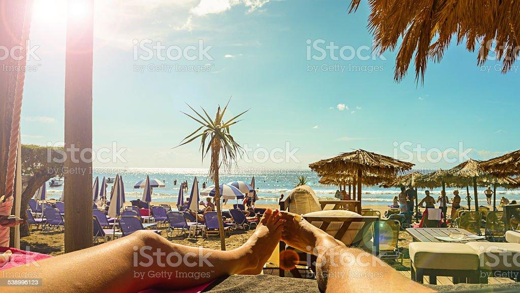 Happy couple enjoy on beach & pov & canopy chaise stock photo