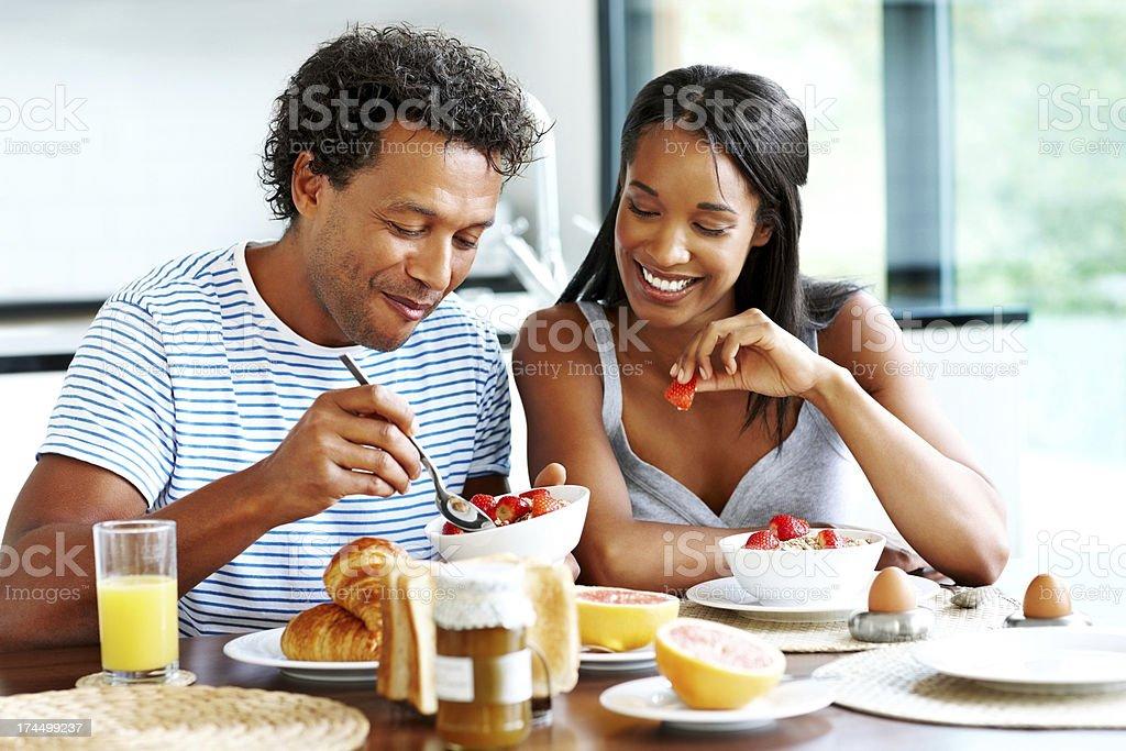 Happy couple enjoying breakfast together royalty-free stock photo