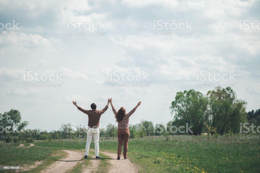 Happy couple enjoying nature on the grassland - Royalty-free Adult Stock Photo