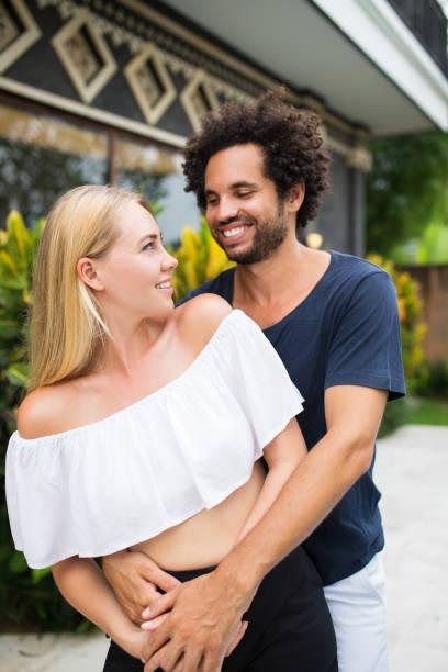 Happy couple enjoying summer vacation together stock photo
