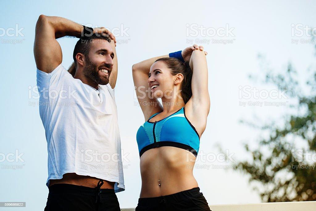 Happy couple exercising outdoors. stock photo