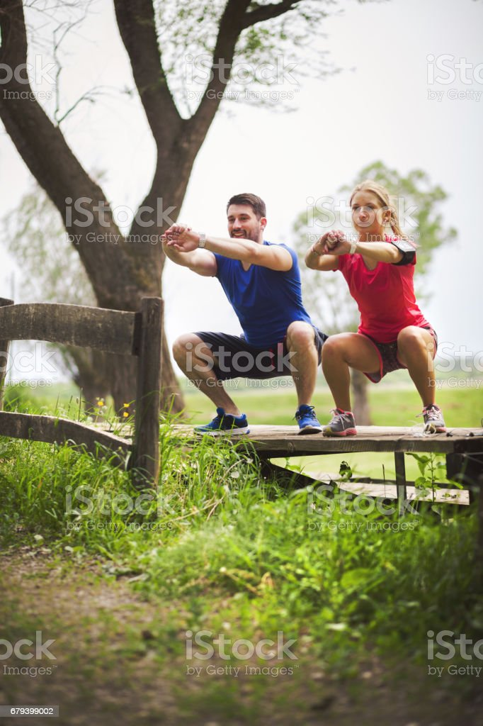 Happy couple exercising outdoors royalty-free stock photo