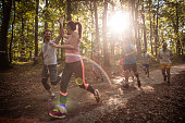 istock Happy couple giving high-five while running marathon race in nature. 956840448