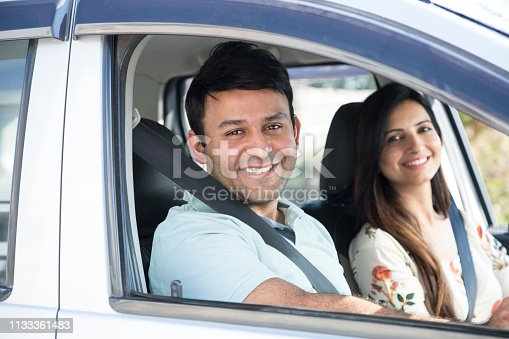 628541610 istock photo Happy couple going on a road trip - Stock image 1133361483
