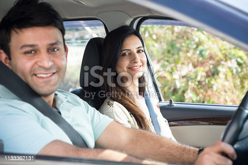 628541610 istock photo Happy couple going on a road trip - Stock image 1133362131