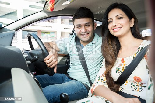 628541610 istock photo Happy couple going on a road trip - Stock image 1133362236