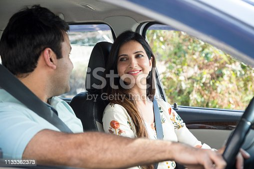 628541610 istock photo Happy couple going on a road trip - Stock image 1133362373