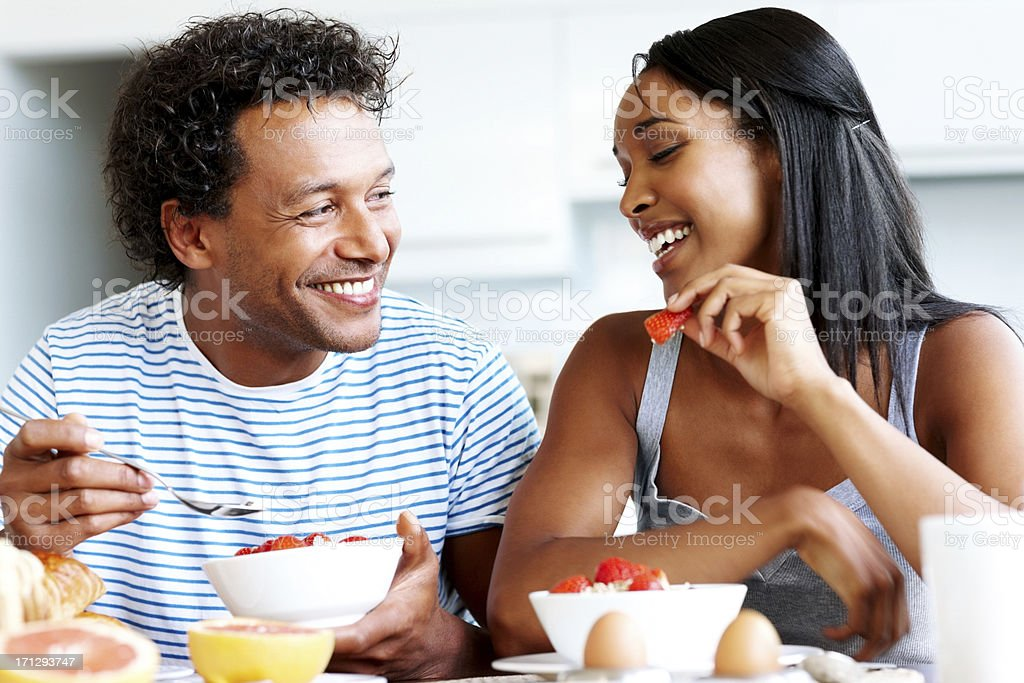 Happy couple having casual chat at breakfast table royalty-free stock photo
