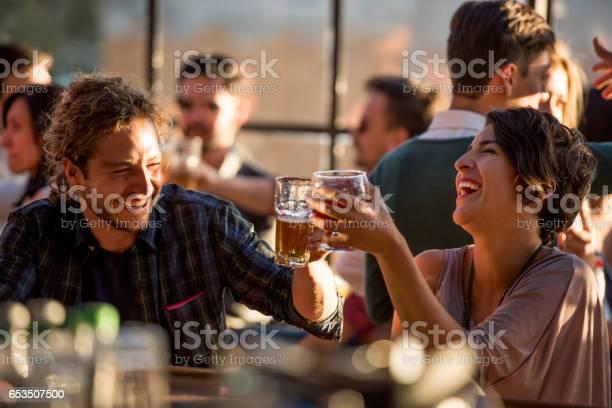 Happy couple having drinks at a bar picture id653507500?b=1&k=6&m=653507500&s=612x612&h=zr3vuveupyvvzbzvou2jf9cla xnu0ksnmgrf0pvga8=