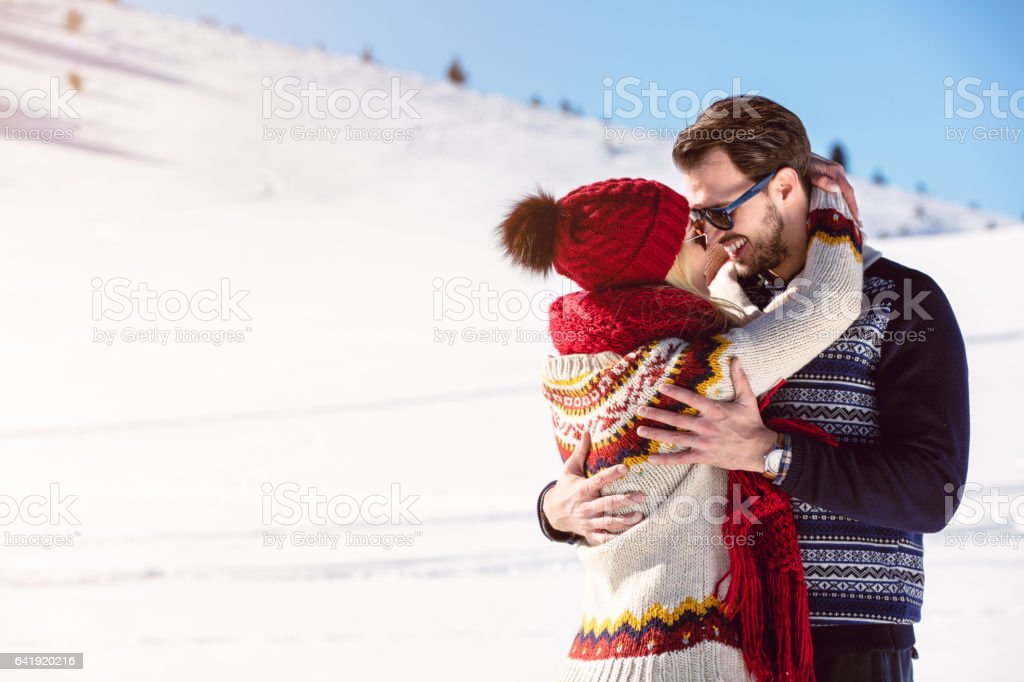 Happy Couple Having Fun on snow mountain. stock photo