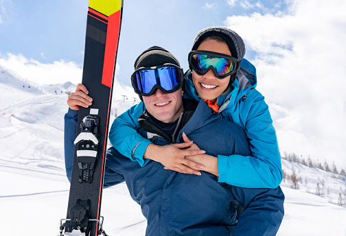 Happy couple having fun skiing in the Alps