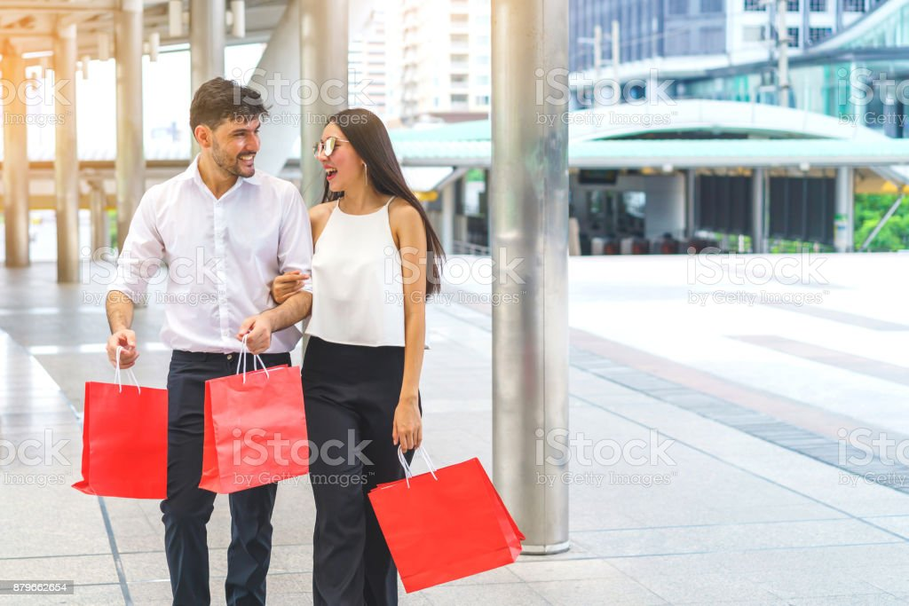 d33337602a Customer, Shopping, Smiling, Store, Street. Happy couple hold shopping bags  walking ...