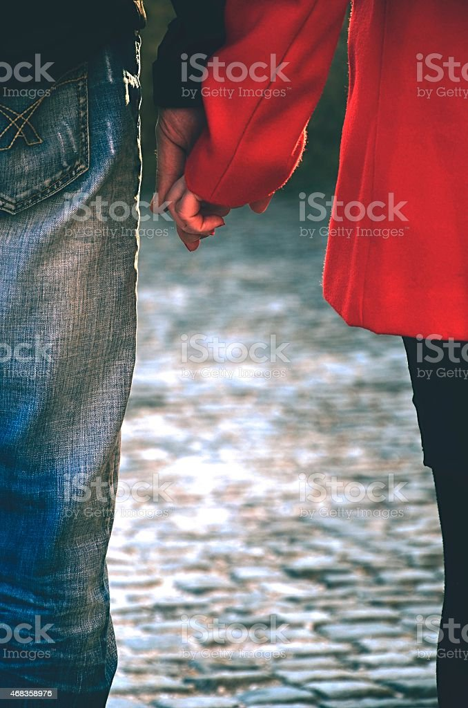 Happy couple holding hands royalty-free stock photo