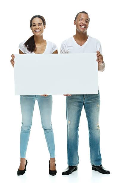happy couple holding placard - heiratssprüche stock-fotos und bilder