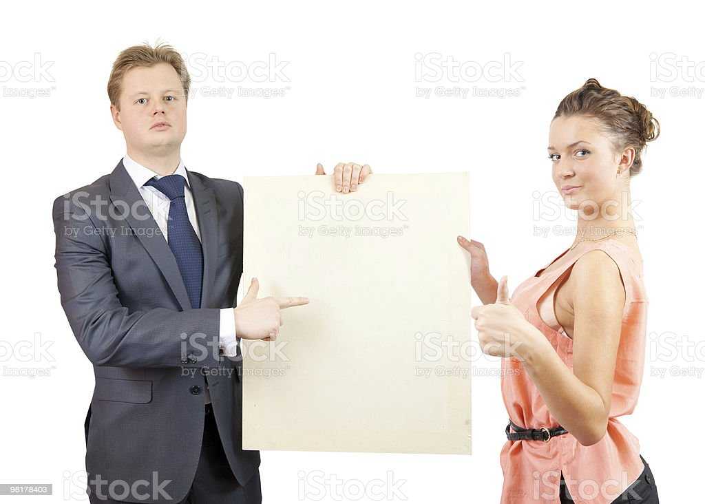 Happy couple holds blank canvas royalty-free stock photo
