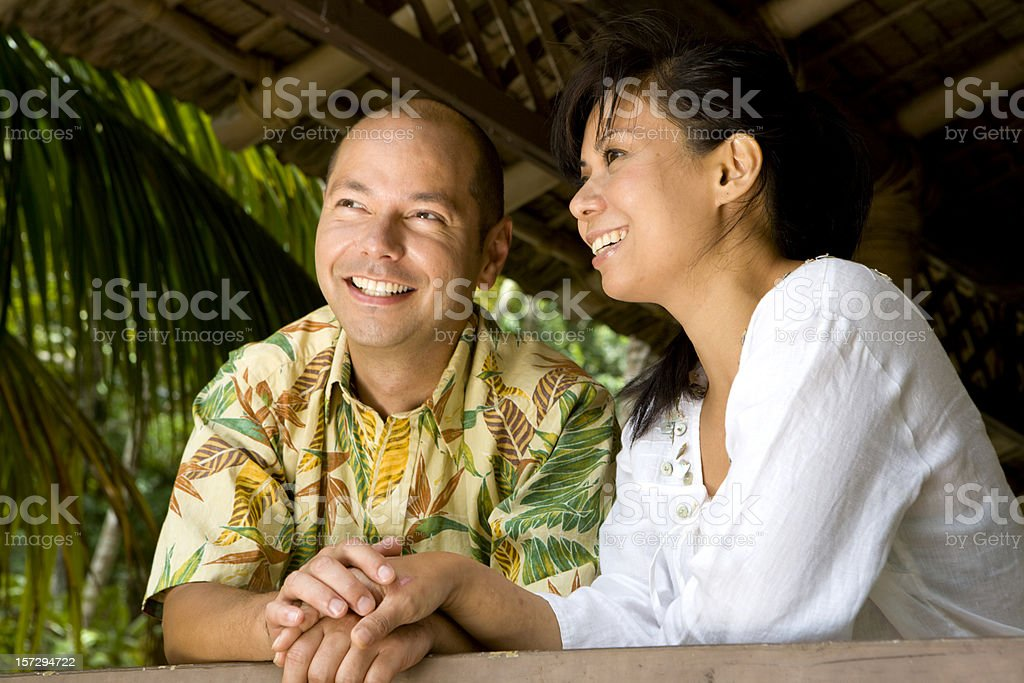 Happy Couple Holds Hands stock photo