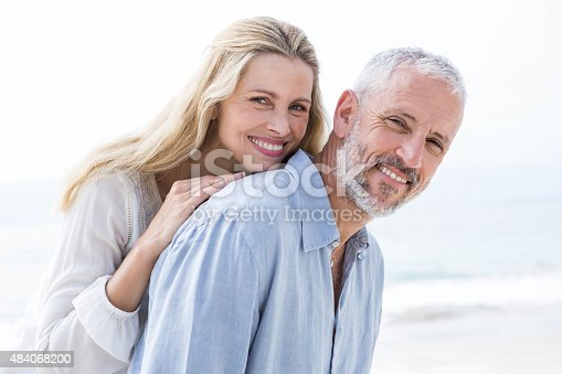 istock Happy couple hugging each other and smiling at camera 484068200