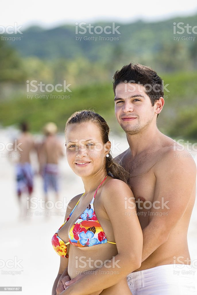 Happy couple hugging in a tropical beach royalty-free stock photo