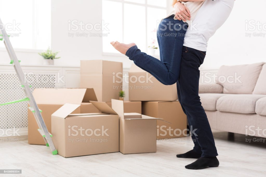 Happy couple hugging near unpacked boxes Crop of happy couple hugging near unpacked boxes in new apartment, copy space Adult Stock Photo