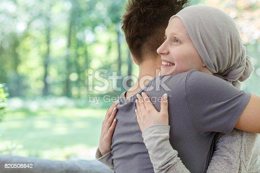 istock Happy couple hugging 820508642