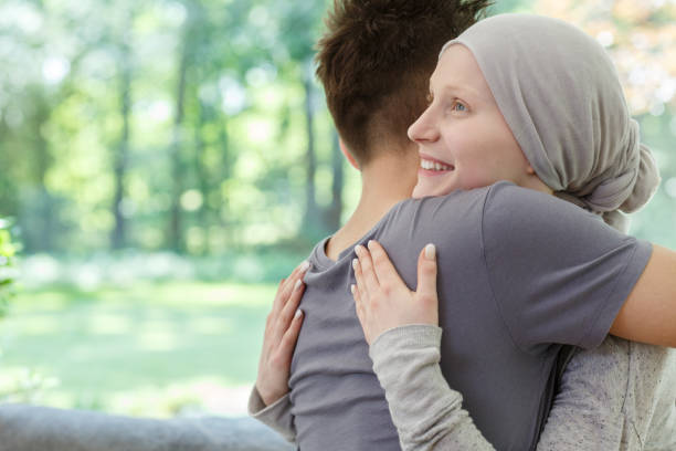 Happy couple hugging Young happy couple hugging after hearing the good news chemotherapy cancer stock pictures, royalty-free photos & images