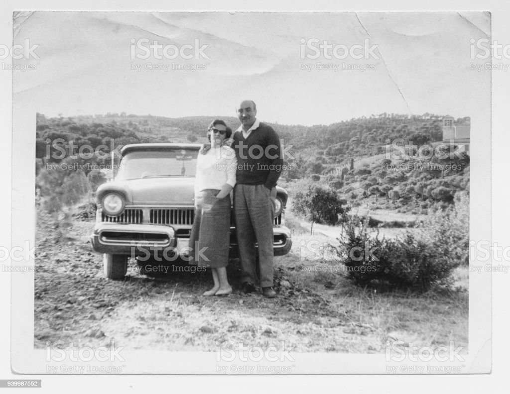 Happy couple in 1950 with car stock photo