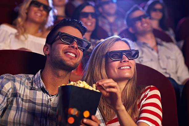 happy couple in 3d movie - movie theater stock photos and pictures