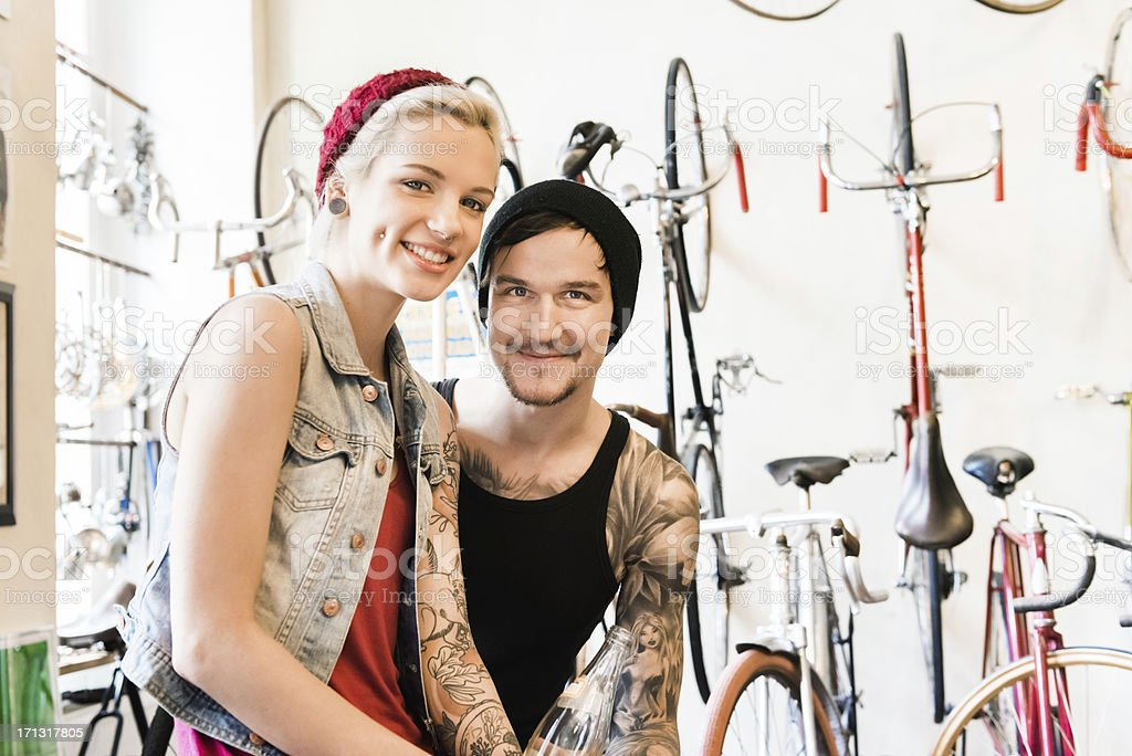 Happy Couple in a Bike Store stock photo