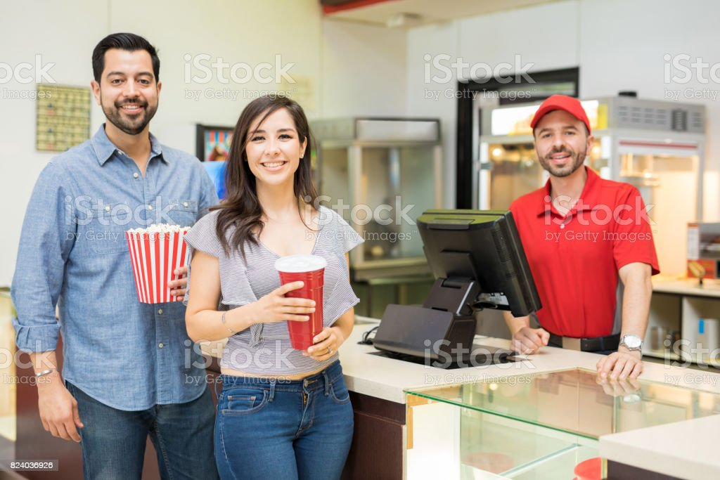 Happy couple in a concession stand stock photo