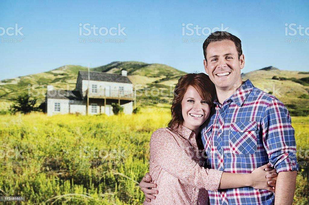 Happy couple in a farm royalty-free stock photo