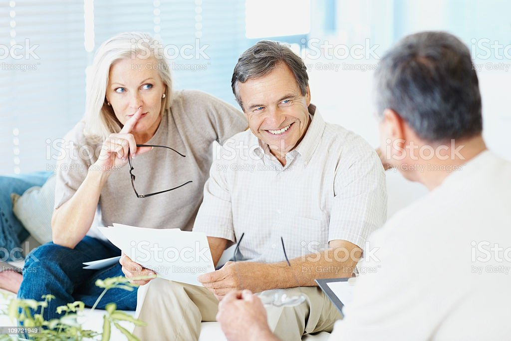 Happy couple in a meeting with bank manager royalty-free stock photo