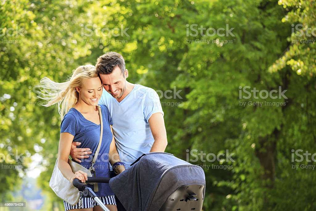 Happy couple in a park stock photo
