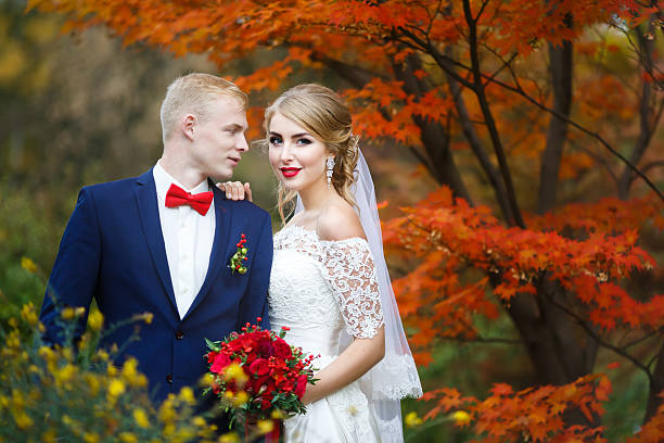 Happy couple in autumn forest