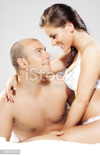 istock happy couple in bed 182737014