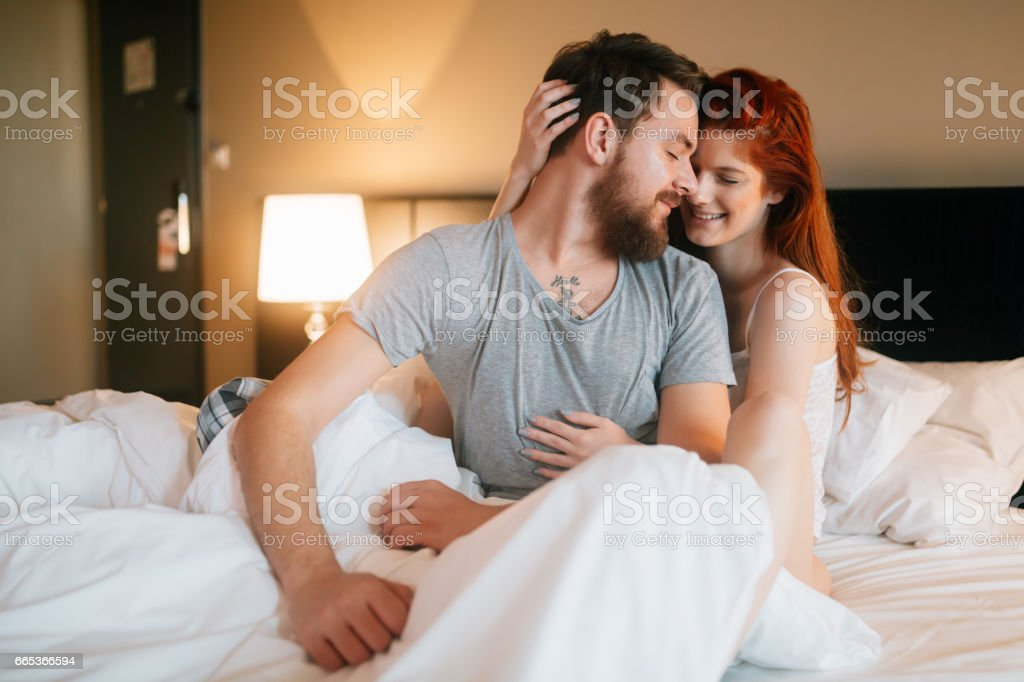 Happy Couple In Bedroom Enjoying Sensual Foreplay Royalty Free Stock Photo