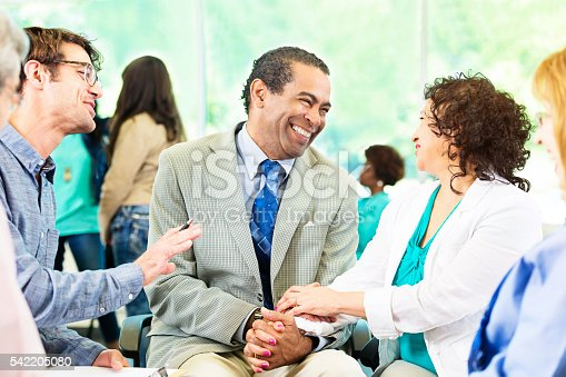669854210 istock photo Happy Couple in group therapy 542205080