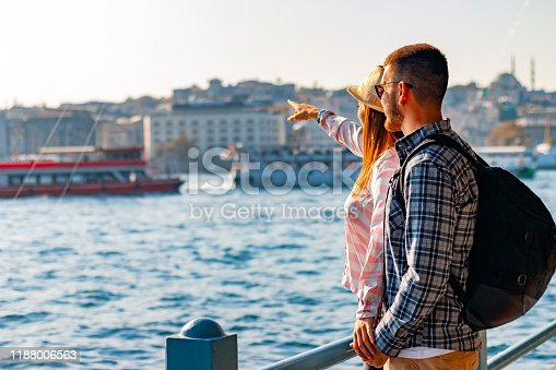 Young Couple traveling together in bright casual plaid Clothing , Istanbul the capital of Turkey, eastern tourist city.