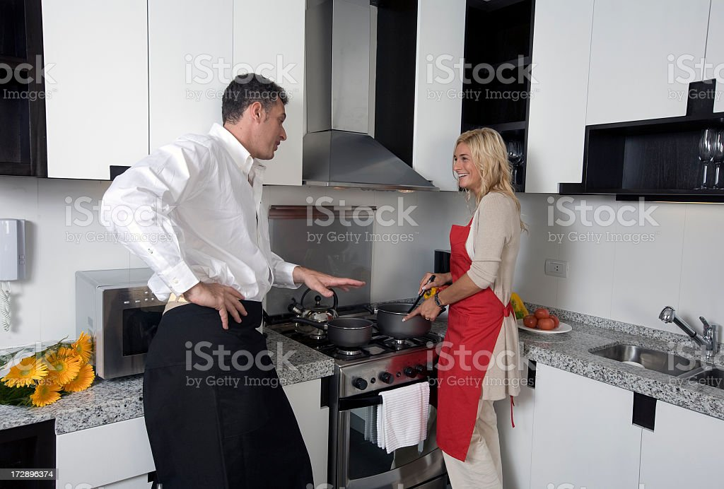 Happy couple in kitchen royalty-free stock photo