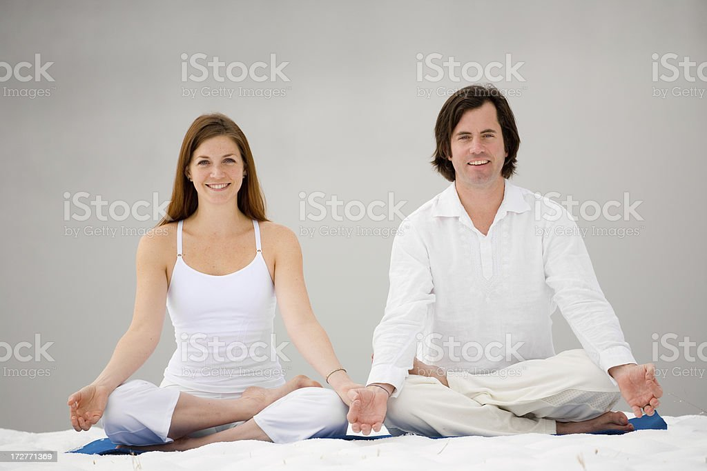 Happy Couple in Lotus Position royalty-free stock photo