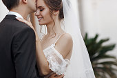 istock Happy couple in love, bride and groom cuddle and look at each other 1255725050