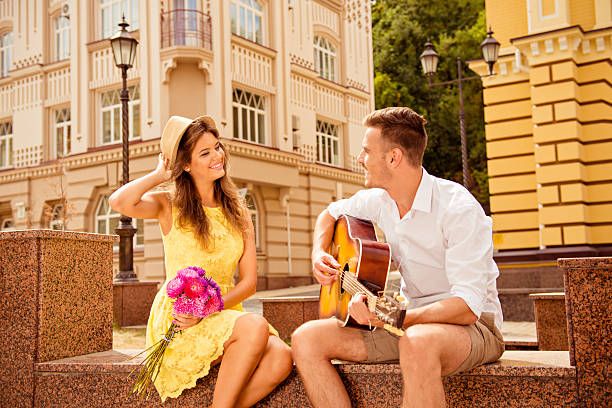 Happy couple in love dating Happy couple in love dating serenading stock pictures, royalty-free photos & images