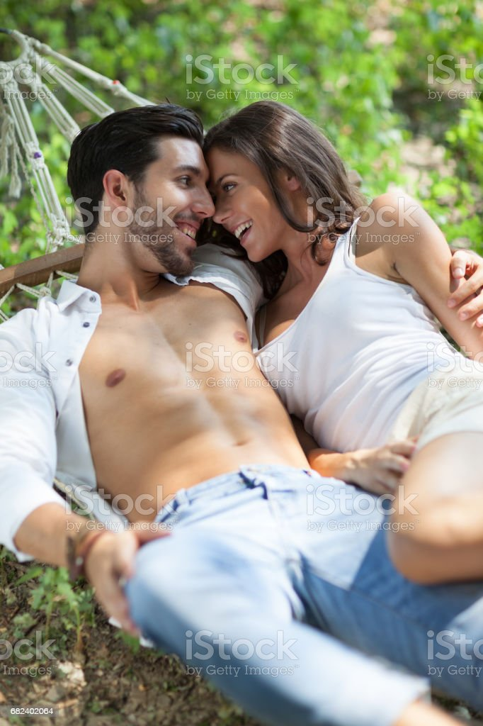 happy couple in love in hammock,selective focus royalty-free stock photo