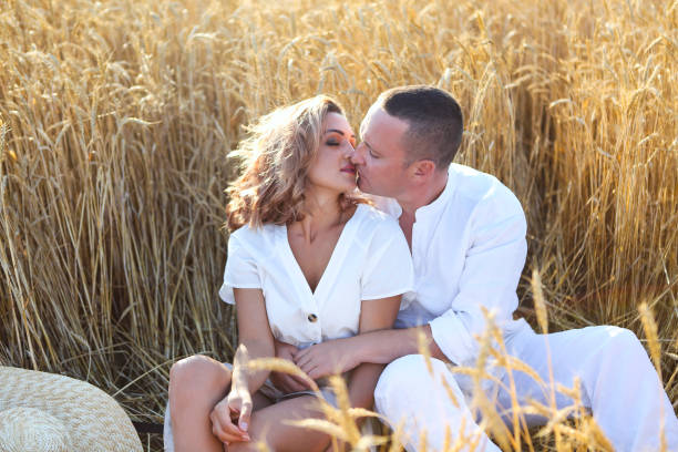 Happy couple in love in wheat field stock photo