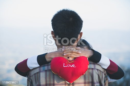 950598260 istock photo Happy couple in love. Man and woman tourists in the mountains. Happy Valentine's Day. 1159029521